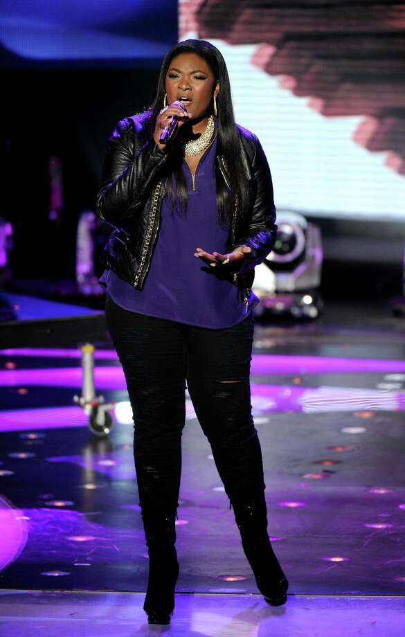 FILE - In this Wednesday, May 1, 2013 photo released by FOX, contestant Candice Glover performs onstage at FOX's American Idol Season 12 Top 4 To 3 Live Performance Show, in Hollywood, Calif. The current 12th season is set to conclude next Thursday, May 16, 2013, with a showdown between the 23-year-old R&B vocalist Glover of St. Helena Island, S.C., and 22-year-old country crooner Kree Harrison of Woodville, Texas. (AP Photo/FOX, Frank Micelotta) Photo: Frank Micelotta, HONS / FOX