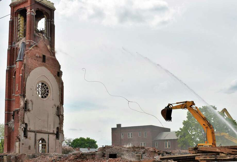 Cables being used to pull down the bell tower at the former St. Patrick's Church in Watervliet, NY snap delaying demolition yet again Friday May 10, 2013.  (John Carl D'Annibale / Times Union) Photo: John Carl D'Annibale / 00022324A