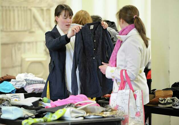 UAlbany staff members Tuuli Edwards, left, and Ashley Kravitz look for clothes during a clothing swap held in the University at Albany campus center ballroomon Thursday, April 18, 2013 in Albany, N.Y.  (Lori Van Buren / Times Union) Photo: Lori Van Buren