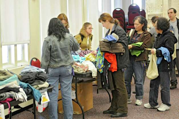 People look for clothes during a clothing swap held in the University at Albany campus center ballroomon Thursday, April 18, 2013 in Albany, N.Y.  (Lori Van Buren / Times Union) Photo: Lori Van Buren