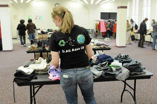UAlbany senior Jessica Fine, 20, of Syracuse  looks for clothes during a clothing swap held in the University at Albany campus center ballroomon Thursday, April 18, 2013 in Albany, N.Y.  (Lori Van Buren / Times Union) Photo: Lori Van Buren