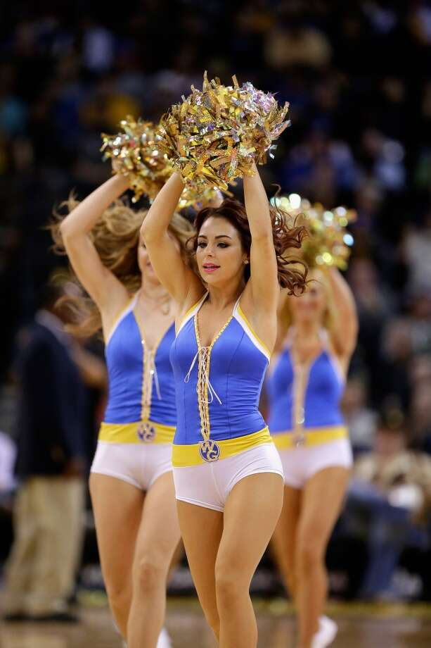 Members of the Warrior Girls, the Golden State Warriors cheerleaders, perform during their game against the New Orleans Hornets at Oracle Arena on December 18, 2012 in Oakland, California.