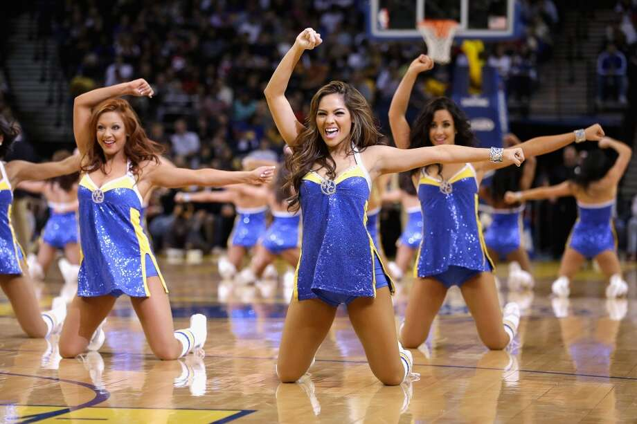 The Golden State Warriors cheerleaders, cheers during their game against the Los Angeles Clippers at Oracle Arena on January 21, 2013.