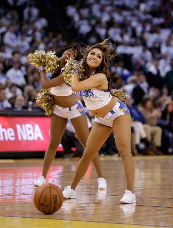 A member of the Warrior Girls, the Golden State Warriors cheerleaders, performs during their game against the Los Angeles Clippers.