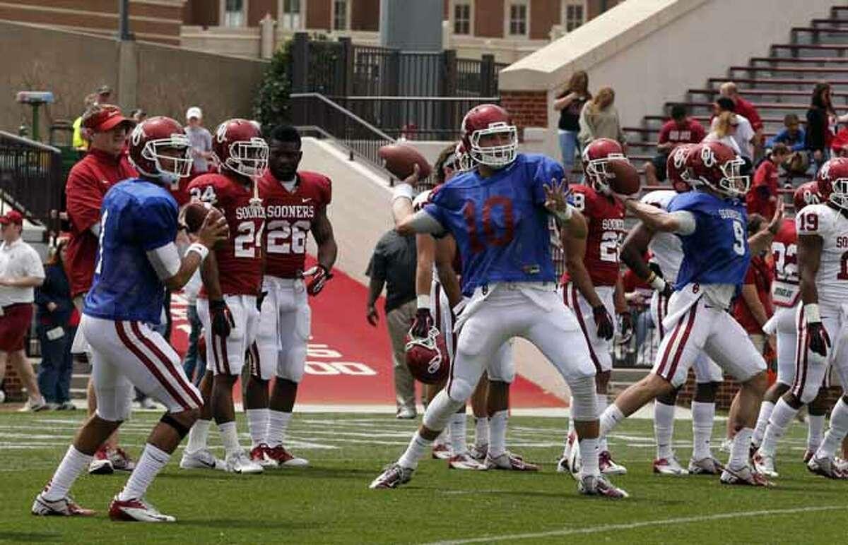 Oklahoma quarterbacks Kendall Thompson (1), Blake Bell (10) and Trevor Knight (9) throw before the start of the annual Oklahoma spring intra-squad NCAA college football game in Norman, Okla., Saturday, April 13, 2013. (AP Photo/Sue Ogrocki)