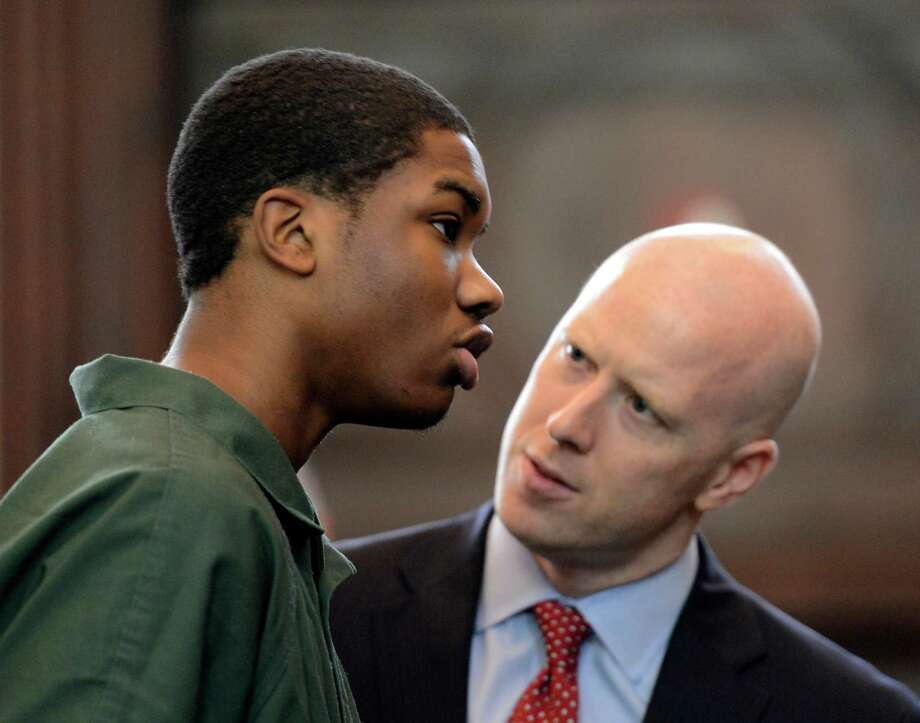Keith Ferguson, left, with his attorney Lee Kindlon, takes a plea deal in front of Judge Patrick McGrath May 10, 2013 at the Rensselaer County Courthouse in Troy, N.Y. and received 10 years in state prison for robbery    (Skip Dickstein/Times Union) Photo: SKIP DICKSTEIN / 00022349A