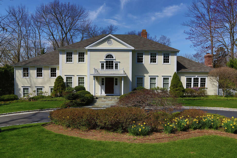 This newer Colonial at 53 Old Hill Road, built in 1991, features many recent upgrades, including a Premium Line 50-year roof with leaders and gutters, a high-efficiency heating system and redone kitchen and master bath, among other improvements. Photo: Contributed Photo