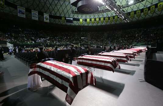 Honor guard stand in front of caskets prior to the memorial service. (AP Photo/Eric Gay)