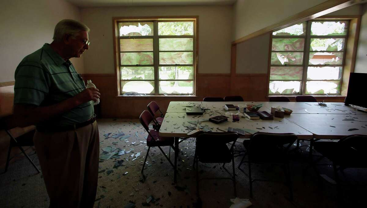 Five days after the fertilizer plant explosion, Pastor Curtis Holland looks over damage at West Brethren Church on Monday.