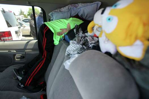 Samuel Arias, 5, looks for a juice drink inside his parents car where they have loaded with donated clothes and other supplies on Saturday, April 20, 2013, in West. Photo: Mayra Beltran, Houston Chronicle / © 2013 Houston Chronicle