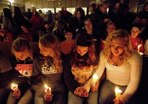 West's Rachael Zacharias, 13; Kyndall Hoelscher, 14; Morgan Talamatez, 17, and Bailee Kendrick, 17, attend a candlelight vigil at St. Mary's of Assumption Catholic Church. More than 500 people gathered to mourn those hurt and killed in the fertilizer plant explosion. Photo: Johnny Hanson, Houston Chronicle / © 2013  Houston Chronicle