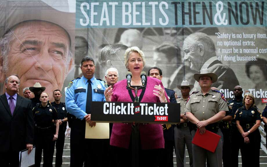 Mayor Annise Parker speaks during the launch of the Texas Department of Transportation's 12th annual Click It or Ticket campaign in front of City Hall on May 9. (Cody Duty / Houston Chronicle) Photo: Cody Duty, Staff / © 2013 Houston Chronicle