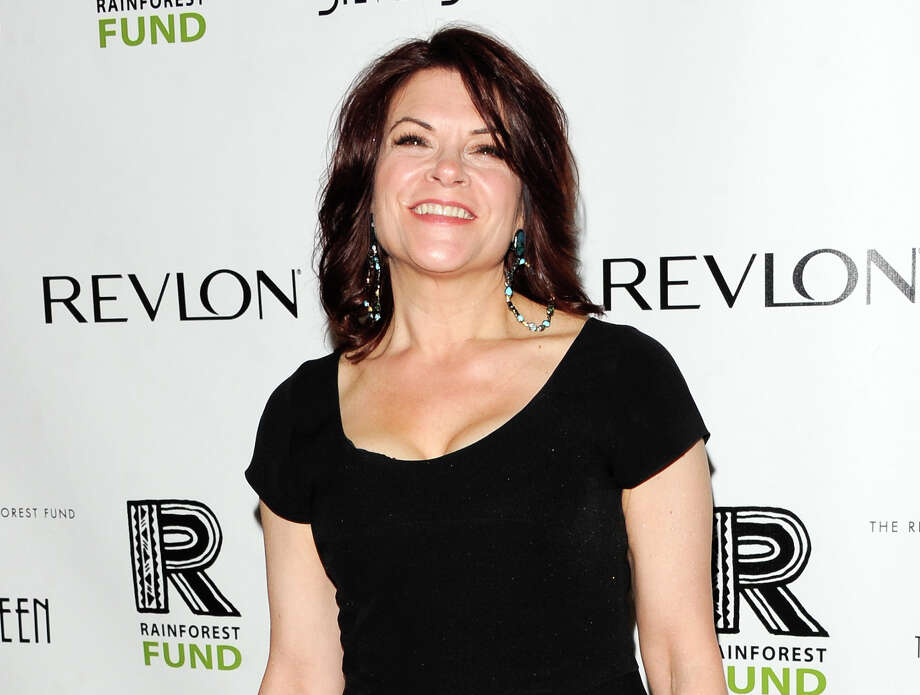 FILE - This April 3, 2012 file photo shows singer Rosanne Cash at the Revlon Concert for the Rainforest Fund dinner and auction in New York. Cash has been a New Yorker for two decades now. Her latest project is taking her out of the city. She's preparing a new album of songs about the American South, and did a lot of traveling with her husband, John Leventhal to get ideas.  (AP Photo/Evan Agostini, file) Photo: Evan Agostini