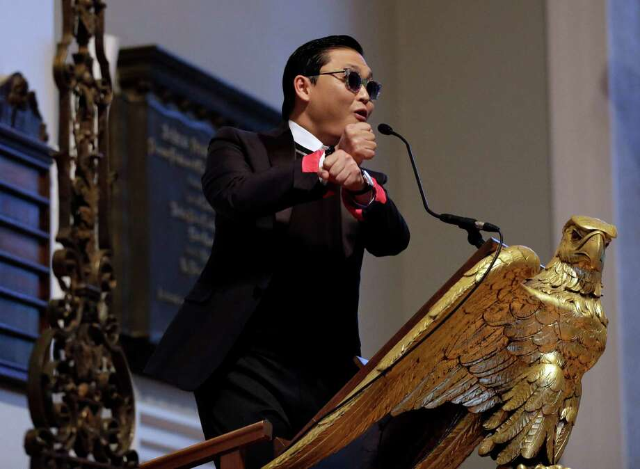 Korean pop star PSY speaks in Memorial Church at Harvard University in Cambridge, Mass., Thursday, May 9, 2013. Dozens of screaming and shouting Harvard University students welcomed South Korean pop star PSY for a conversation inside the ornate church dedicated to the memory of those who lost their lives in World War I. (AP Photo/Elise Amendola) Photo: Elise Amendola