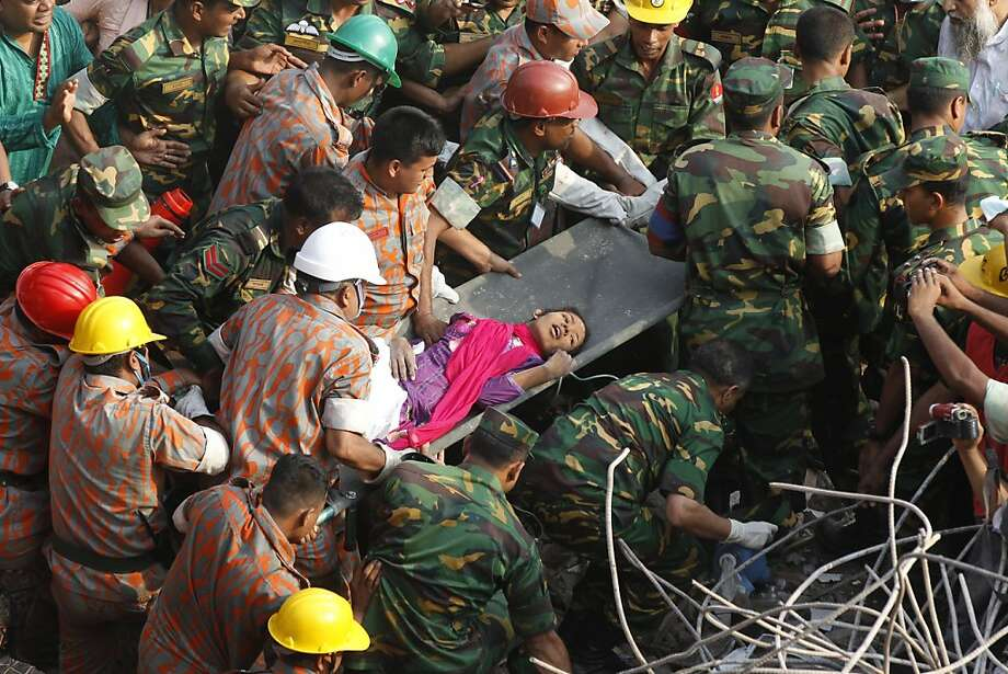 Trapped for 17 days but still alive:Bangladeshi rescuers carry a garment worker named Reshma out of the rubble of the collapsed factory complex in Savar. She had been in a Muslim prayer room when the structure caved-in on April 24. The death toll in the world's worst garment industry disaster rose to more than 1,000 as piles of bodies were found in the ruins of a stairwell where victims had sought shelter. Photo: Strdel, AFP/Getty Images
