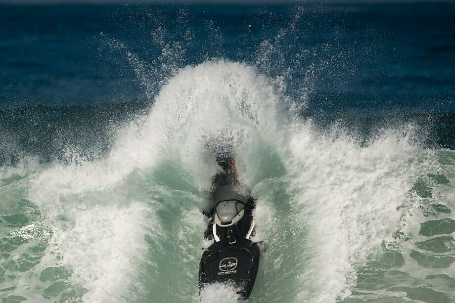 Safeguarding the surfers,a rescue personal watercraft crashes through a wave during the first day of ASP world tour Billabong Rio Pro 2013 at Barra de Tijuca beach in Rio de Janeiro. Photo: Christophe Simon, AFP/Getty Images