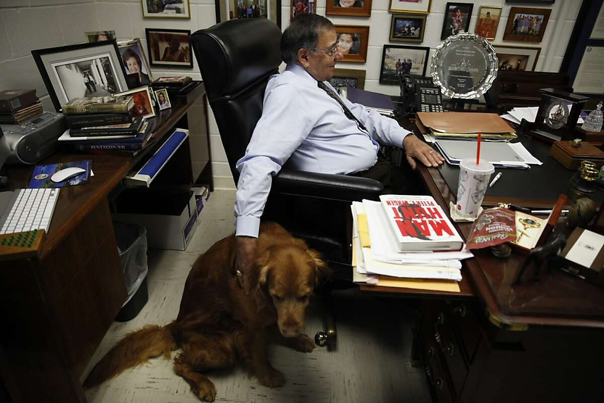 Former Defense Secretary Leon Panetta pats his dog Bravo while sitting at his desk in his office at The Panetta Institute for Public Policy on Tuesday, April 16, 2013 in Seaside, Calif.