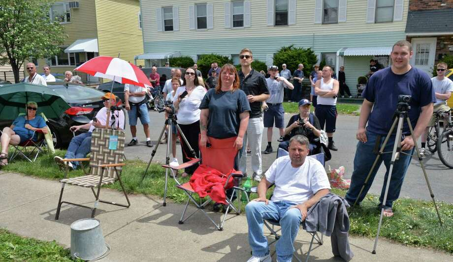 Residents watch as demolition continues on the former St. Patrick's Church in Watervliet, NY Friday May 10, 2013.  (John Carl D'Annibale / Times Union) Photo: John Carl D'Annibale, Albany Times Union / 00022324A