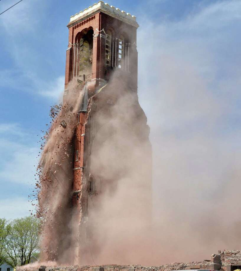 The sides of the bell tower at the former St. Patrick's Church in Watervliet, NY are pulled apart as demolition continues Friday May 10, 2013.  (John Carl D'Annibale / Times Union) Photo: John Carl D'Annibale, Albany Times Union / 00022324A