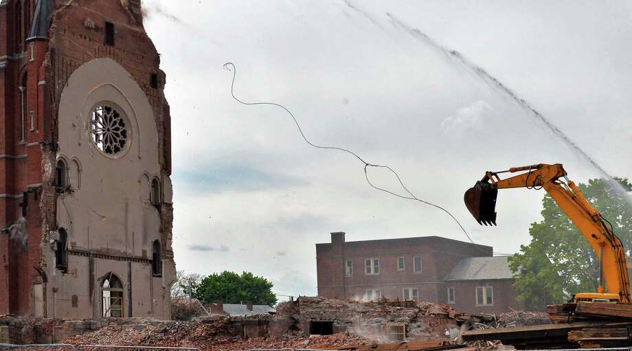 Cables being used to pull down the bell tower at the former St. Patrick's Church in Watervliet, NY snap delaying demolition yet again Friday May 10, 2013.  (John Carl D'Annibale / Times Union) Photo: John Carl D'Annibale, Albany Times Union / 00022324A