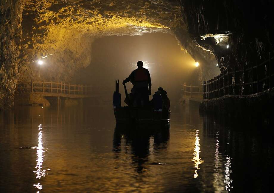 Subterranean cruise: A small rowboat floats inside the Beihai Tunnel in Nangan, Taiwan's Matsu Islands. Once part of a military base, the tunnel is now a popular tourist spot. Photo: Ashley Pon, Getty Images