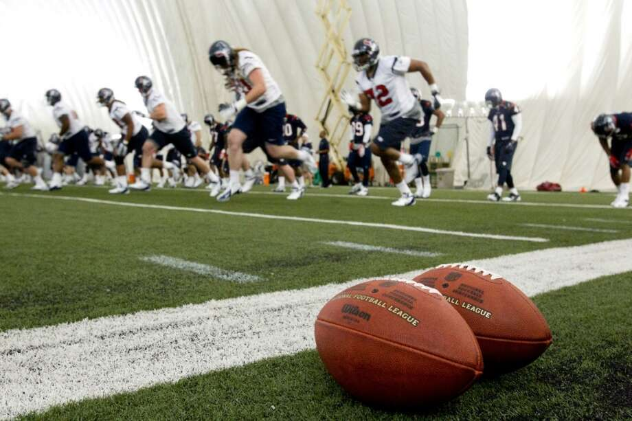 Texans rookies warm up at the beginning of practice during the team's rookie mini-camp at the Methodist Training Center on Friday.