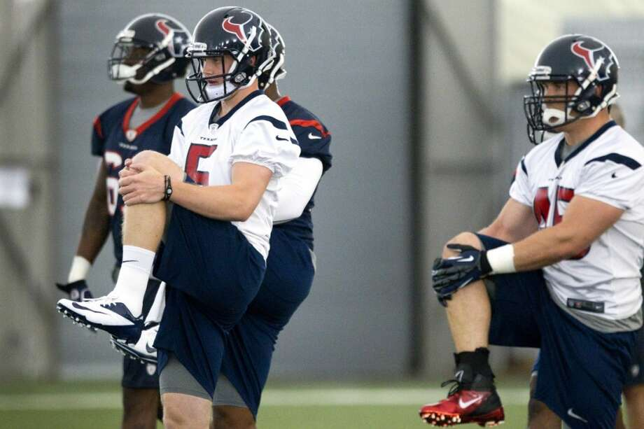 Quarterback Collin Klein (5) and fullback Zach Boren (45) stretch at the beginning of practice.