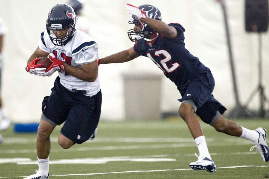 Wide receiver Alec Lemon (17) makes a catch with cornerback Johnny Adams (42) defending.
