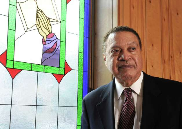 Rev. Dr. Oscar McLaughlin stands near a stained glass window at Walls Temple AME Zion Church on Friday, May 10, 2013 in Albany, N.Y. (Lori Van Buren / Times Union) Photo: Lori Van Buren / 00022322A