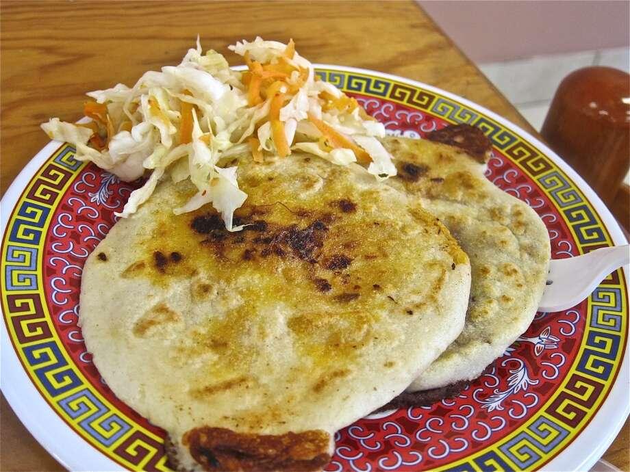 Pupusas mixtas with curtido (cabbage relish) at Pupuseria Emanuel on Edgebrook.