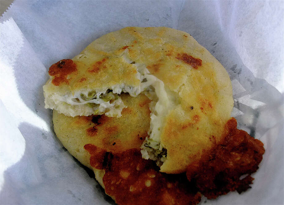 Inside the pupusa de queso y loroco at Pupuseria Emanuel on Telephone Rd.
