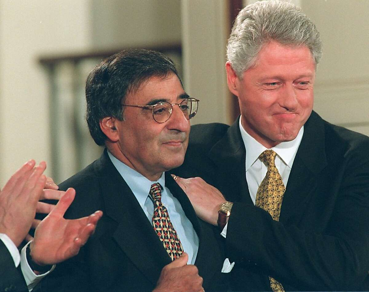President Clinton embraces outgoing White House Chief of Staff Leon Panetta at the White House Friday, Nov. 8, 1996, where he announced Panetta's resignation and that Erskine Bowles would replace Panetta. (AP Photo/Denis Paquin)