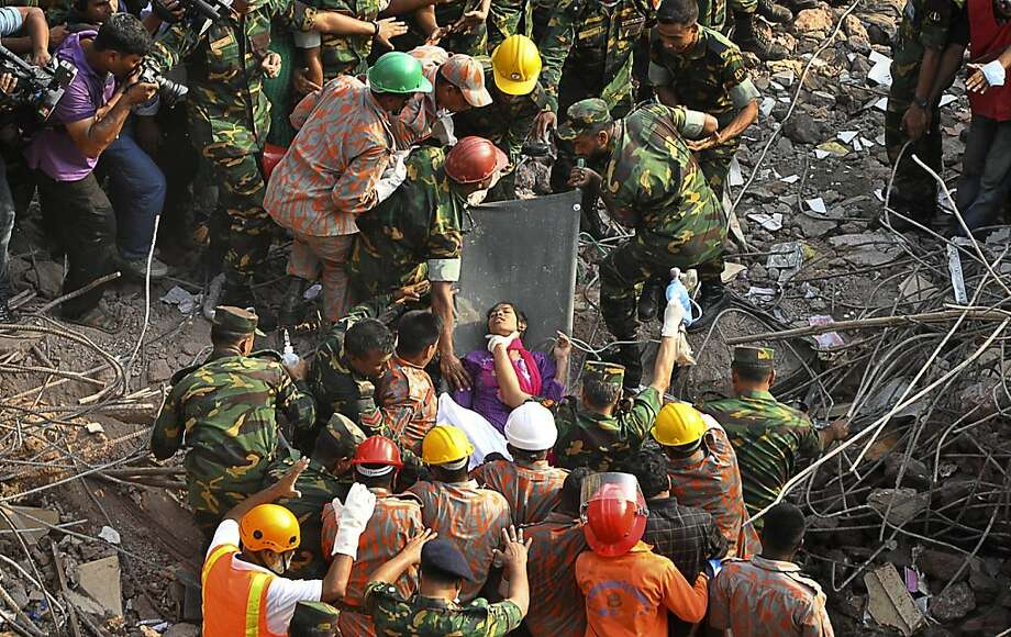 Rescuers carry a survivor pulled out from the rubble of a building that collapsed in Savar, near Dhaka, Bangladesh, Friday, May 10, 2013. Rescue workers in Bangladesh freed the woman buried for 17 days inside the wreckage of a garment factory building that collapsed, killing more than 1,000 people. Soldiers at the site said her name was Reshma and described her as being in remarkably good shape despite her ordeal.  Photo: Associated Press