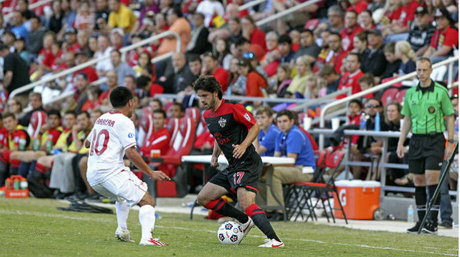 The Scorpions' Blake Wagner (center) brings the ball up against the Atlanta Silverbacks at Toyota field on May 4, 2013. Tom Reel / San Antonio Express-News