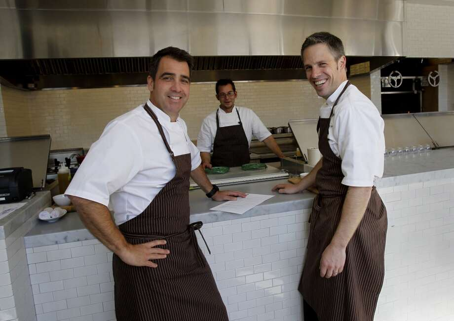 Farmshop chef and owner Jeffrey Cerciello (left) and executive chef Mark Hopper (right) chatting about the dinner menu.