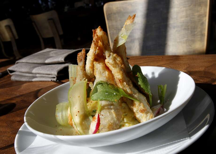 Crispy Half Moon Bay Smelts features butterball potato and Arrowsmith Farm sorrel salad.