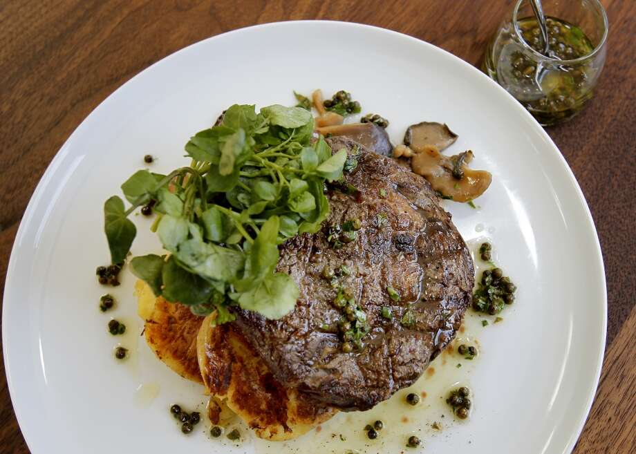 Grilled Marin Sun Farms Ribeye with smashed potatoes, mushroom conserva, Jesse's watercress and green peppercorn salsa.