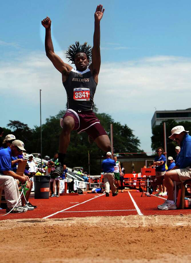 Humble Summer Creek's Greg Hogan competes in the 4A Boys Long Jump during the High School State Track meet at Mike A. Myers Stadium in Austin Friday, May 10, 2013, in Austin. Photo: Cody Duty, Houston Chronicle / © 2013 Houston Chronicle