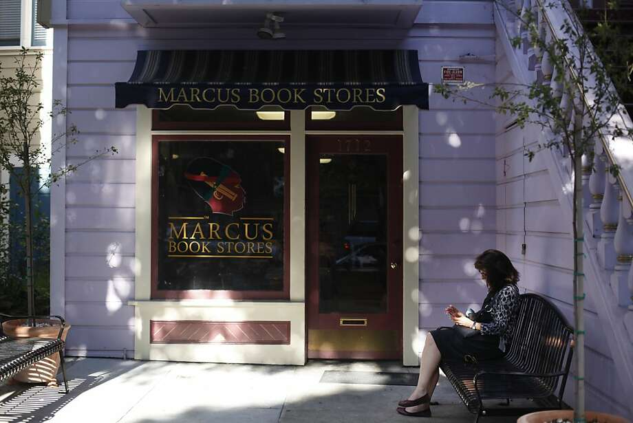 Jayme Maxwell sits in front of Marcus Book Stores in May. The building has been named a landmark. Photo: Lea Suzuki, The Chronicle