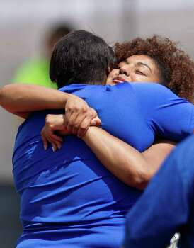 Beaumont Ozen High School's Nekia Jones, left, hugs Richmond Foster High's Alexis Fatheree, right, after the 4A Girls Discus Throw during the High School State Track meet held at Mike A. Myers Stadium in Austin Friday, May 10, 2013, in Austin. Photo: Cody Duty, Houston Chronicle / © 2013 Houston Chronicle
