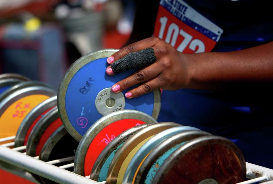 Beaumont Ozen High School's Nekia Jones finds her disc before competing in the 4A Girls Discus Throw during the High School State Track meet held at Mike A. Myers Stadium in Austin Friday, May 10, 2013, in Austin. Photo: Cody Duty, Houston Chronicle / © 2013 Houston Chronicle
