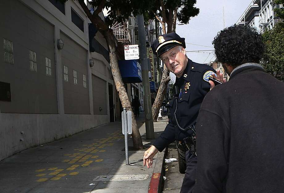 Captain Joe Garrity talks with Mohamed in front of the police station on Eddy St. in San Francisco, Calif., on Wednesday, May 8, 2013. Photo: Liz Hafalia, The Chronicle