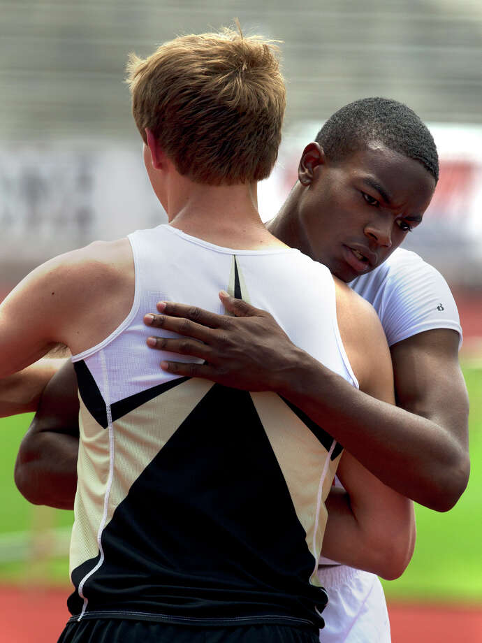 "Nederland's Jared Lorimier, left, hugs Beaumont Central's Landon Malbrough, right, after the two missed a 6'8"" jump during the 4A Boys High Jump held at the state track meet at Mike A. Myers Stadium in Austin Friday, May 10, 2013, in Austin. Photo: Cody Duty, Houston Chronicle / © 2013 Houston Chronicle"