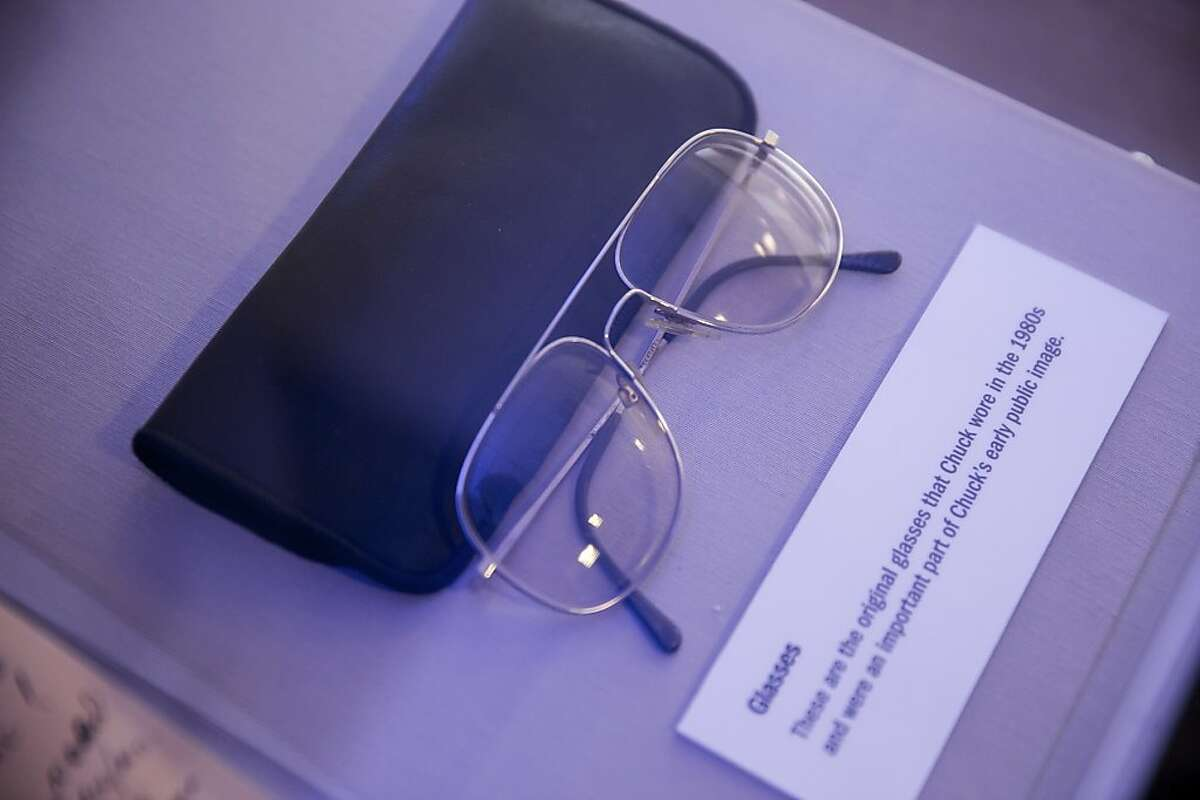 A pair of aviator-style glasses company founder Charles Schwab wore during the 1980s are among mementoes on display in the exhibit marking the company's 40th anniversary.