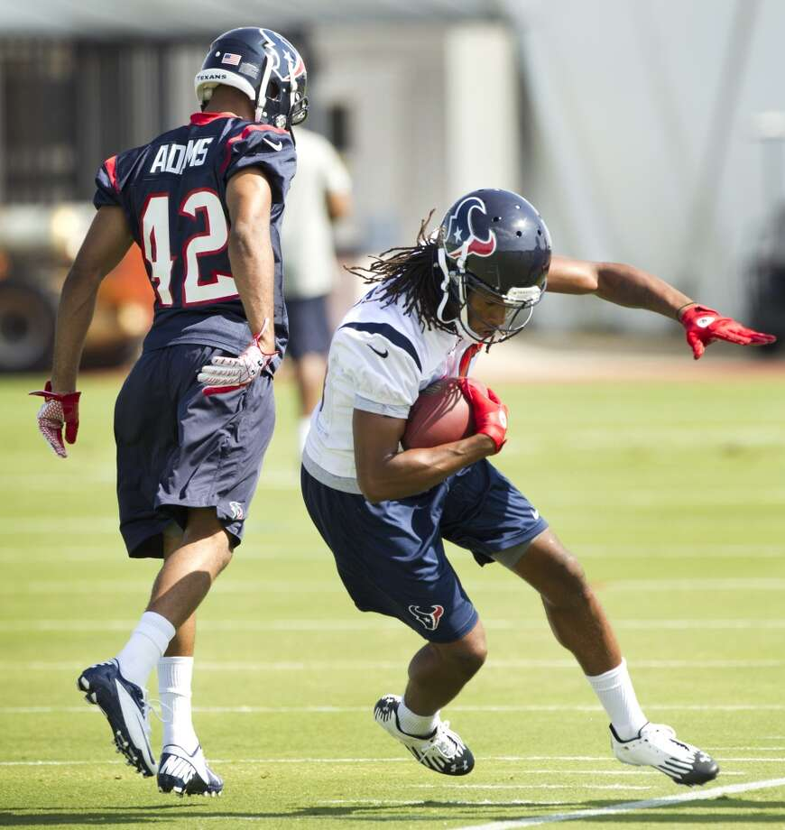 Cornerback Johnny Adams defends a pass to wide receiver DeAndre Hopkins.