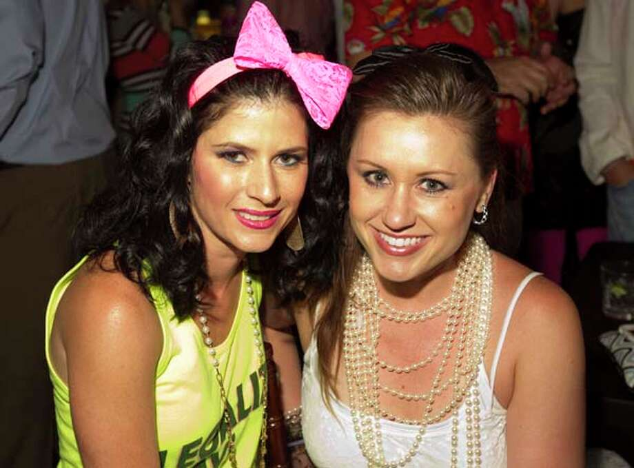 Natasha Gorgue, left, and Jo A. Simmons attend the Camping, Cocktails & Concert! fund raiser benefiting Camp Aranzazu, Thursday, May 9, 2013, in Rockefeller Hall in Houston. Photo: Nick De La Torre, Chronicle / © 2013 Houston Chronicle