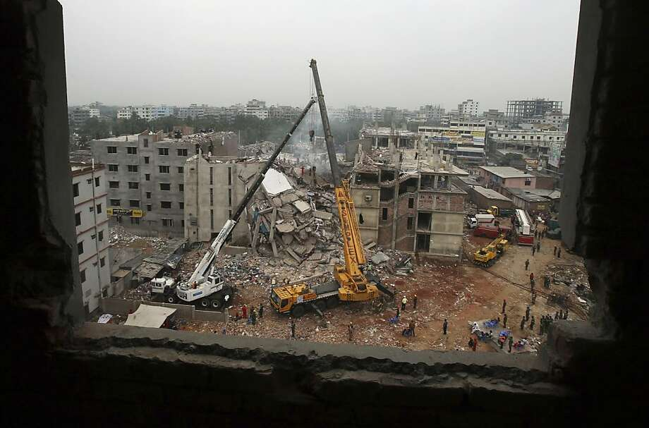 The eight-story Rana Plaza garment factory building collapsed last month, killing more than 1,000 people. U.S. firms face pressure to pay for better safety and more oversight of suppliers. Photo: Wong Maye-E, Associated Press