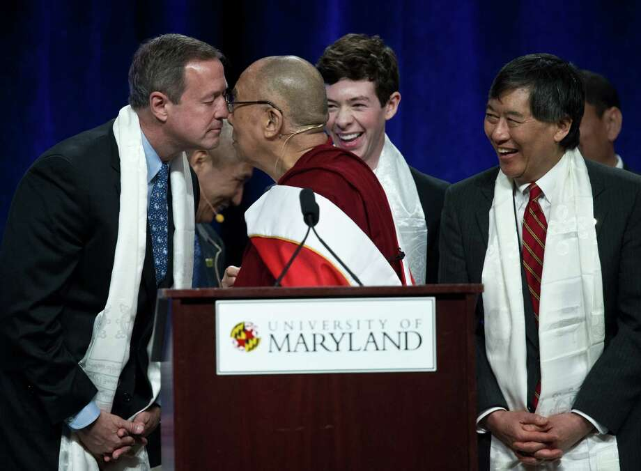 Tibetan spiritual leader the Dalai Lama rubs noses with Gov. Martin O'Malley after delivering the Sadat Lecture for Peace at the University of Maryland in College Park, Md. Photo: Nicholas Kamm / AFP / Getty Images