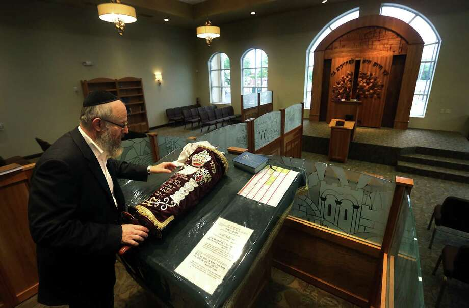 Rabbi Chaim Block places the Torah on the Bema in the new Orthodox synagogue, which sits on 4 acres on Blanco Road. Photo: Photos By Bob Owen / San Antonio Express-News