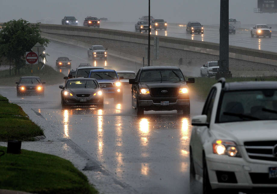 Traffic slows down as Friday's heavy rains limit visibility on Interstate 10. Photo taken Friday, May 10, 2013 Guiseppe Barranco/The Enterprise Photo: Guiseppe Barranco, STAFF PHOTOGRAPHER / The Beaumont Enterprise